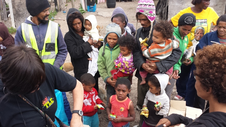 Handing out food and clothes at Atlantis